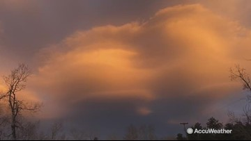 Gorgeous sunset radiates with lenticular clouds