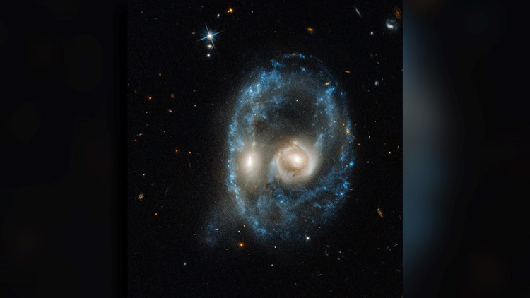 Hubble galaxy collision scary face