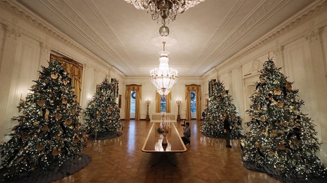 ... with 72 handmade paper ornaments representing six regions across America stand in the East Room of the White House November 26, 2018 in Washington, DC.