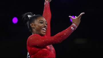 Simone Biles ties worlds medal record with vault win