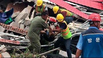 Building under construction topples in Cambodia, killing 15