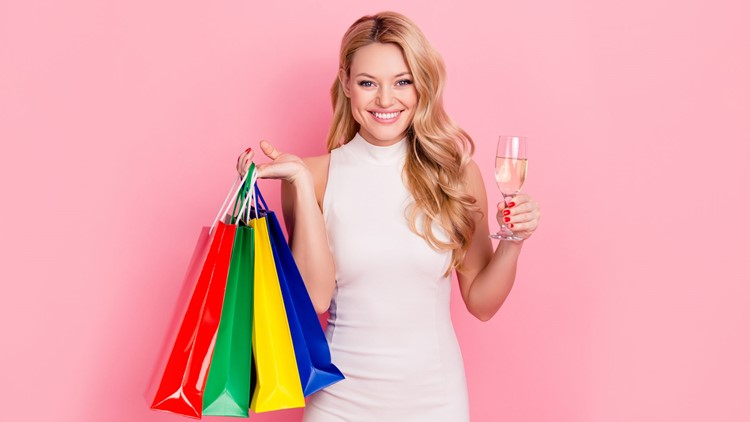 Woman with shopping bags and wine