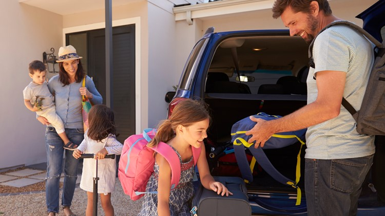 Family getting ready for summer vacation road trip