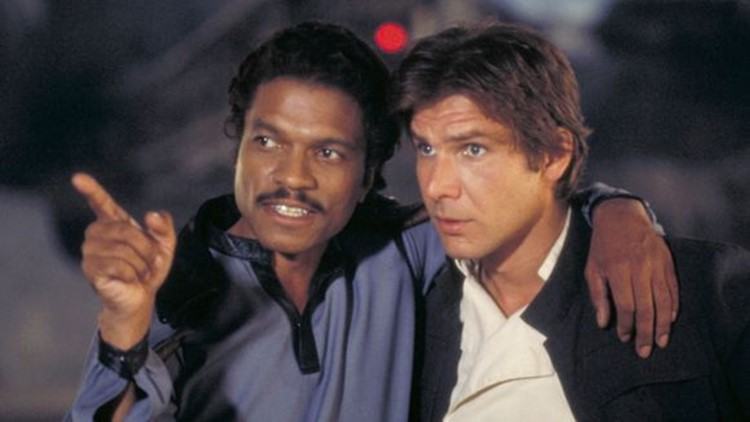 Old friends Lando Calrissian (Billy Dee Williams) and Han Solo (Harrison Ford) reconnect in 'The Empire Strikes Back.'   (Photo: Lucasfilm)