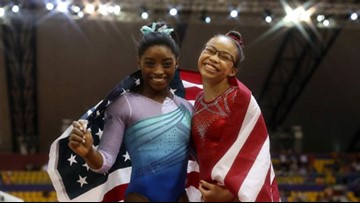 Simone Biles makes history as first woman to win four all-around world titles