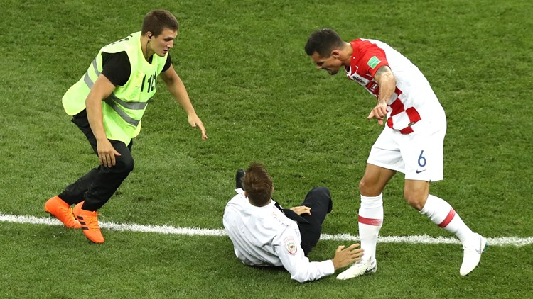A pitch invader is stopped by Dejan Lovren of Croatia during the 2018 FIFA World Cup Final between France and Croatia at Luzhniki Stadium on July 15, 2018 in Moscow, Russia.