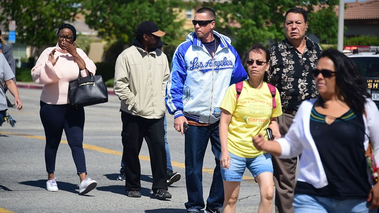 Parents arrive to pick up their children on May 11, 2018 following reports of shooting at Highland High School in Palmdale, 40 miles north of downtown Los Angeles.