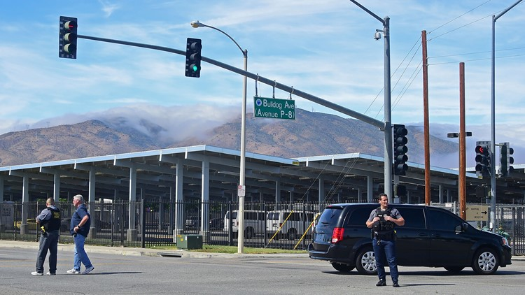 People wait at an intersection May 11, 2018 following reports of shooting at Highland High School in Palmdale, 40 miles north of downtown Los Angeles.