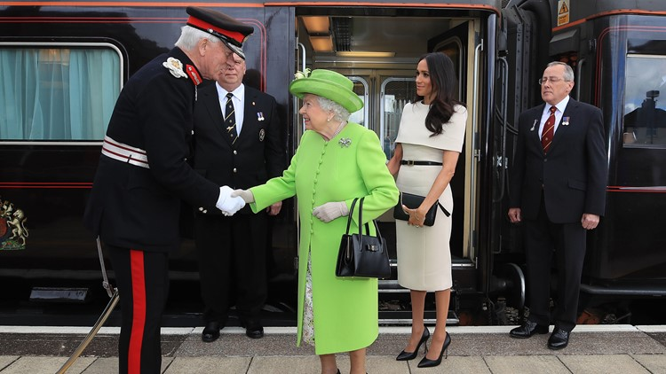 Queen Elizabeth II is greeted with Meghan, Duchess of Sussex as they arrive by Royal Train at Runcorn Station to open the new Mersey Gateway Bridge on June 14, 2018 in the town of Runcorn, Cheshire, England.