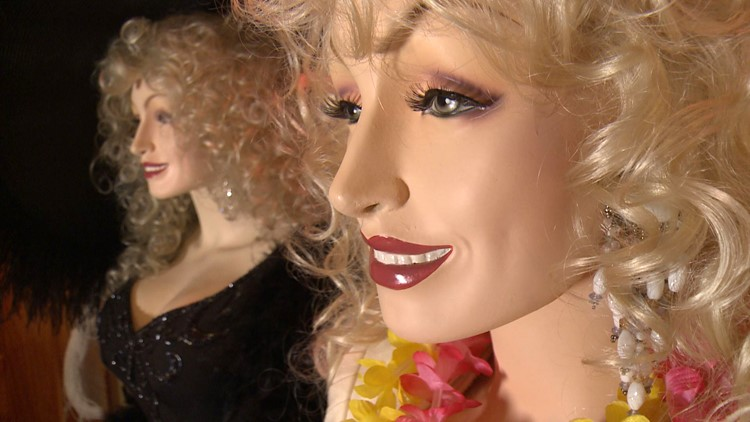 Custom mannequins feature Dolly Parton's measurements and face.