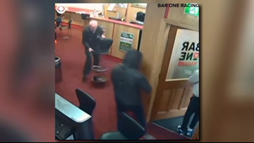GO GRANDPA! Surveillance video shows an older gentleman stopping a would-be robbery