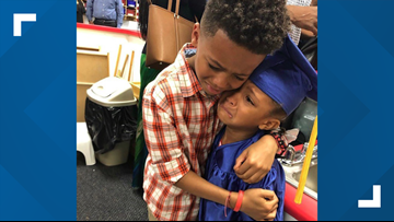 Photo of brother and sister hugging after pre-K graduation warms hearts
