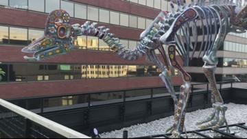 Dinosaur skeleton sits on top of DC hotel