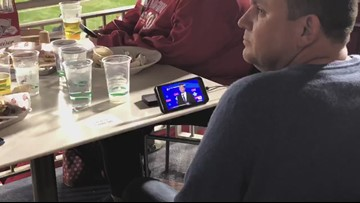 Nationals fan watches Democratic debate while at Game 4 | Most DC Thing