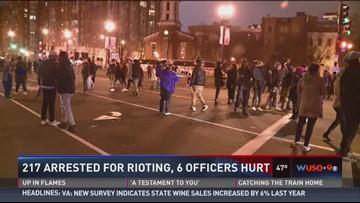 217 arrested for rioting, 6 officers hurt