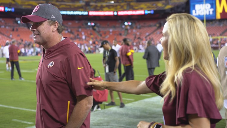 Sherry Gruden with her husband Jay Gruden before game