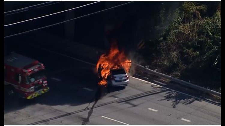 Firefighters extinguish car engulfed in flames on I-495 near Colesville Road