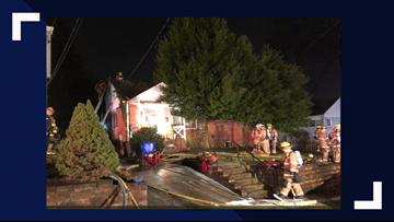 Crews rescue woman trapped in Silver Spring house fire