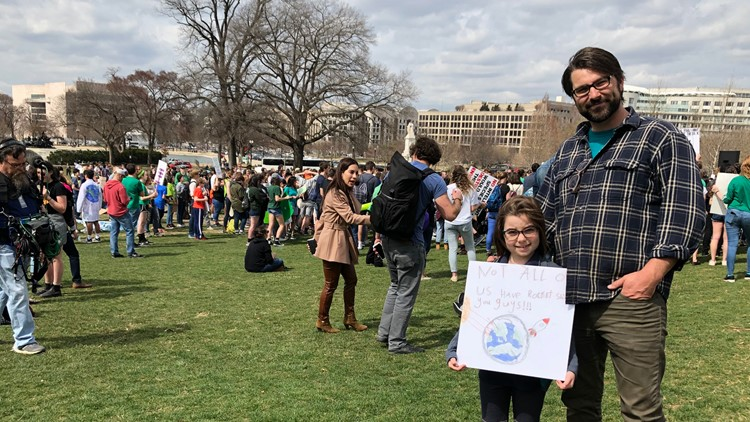 McCamy Cain and dad supporting the Youth Climate Strike
