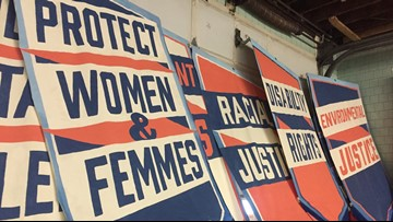 Women and Femmes create art for Women's Day March