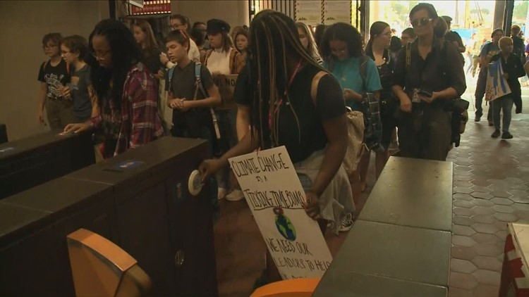 Young people flock to Silver Spring Metro for School Walkout against climate change, on their way to the Capitol