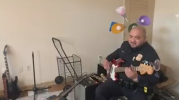 Prince George's County police officer plays guitar for man with autism