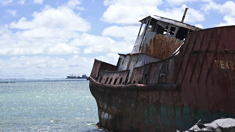 There are picturesque scenes fit for a postcard, but the remnants of a horrific, bloody war remain. Sandy beaches and turquoise waters give way to bunkers, ghost ships, and extreme poverty.
