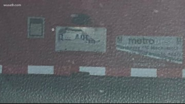 A Metrobus has its licensed plate covered up