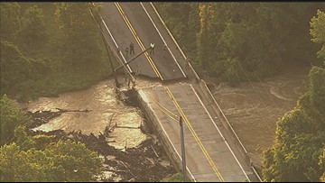 Road washed out, car swept away due to flood water in Laurel