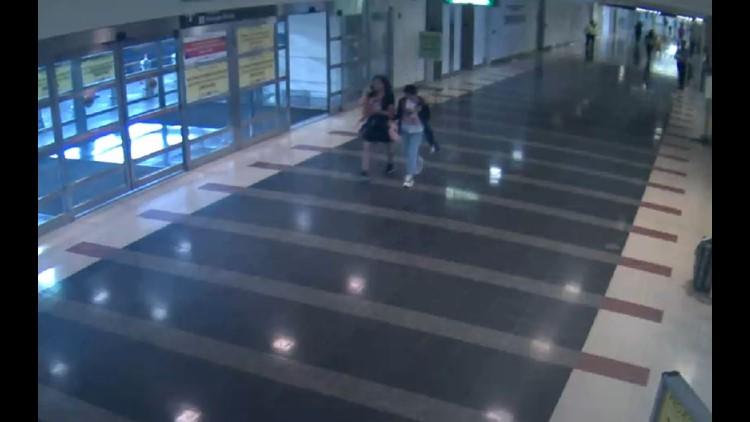 suspect and child baggage claim_1533263563201.JPG.jpg