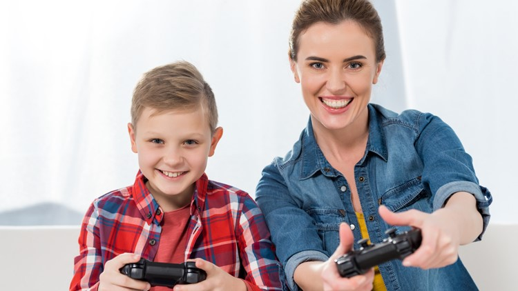 Mom and kid playing video games