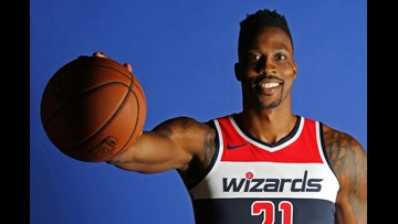 Wizards' Howard could miss start of camp