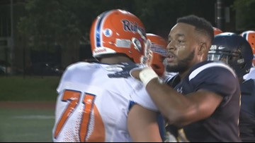 Watch the once-homeless DC high school football player return triumphantly to the field