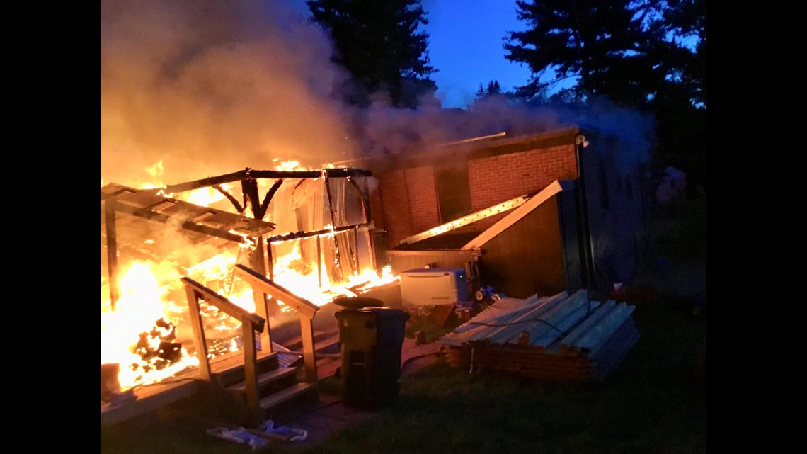 PHOTOS: Officer rescues 2 from burning house