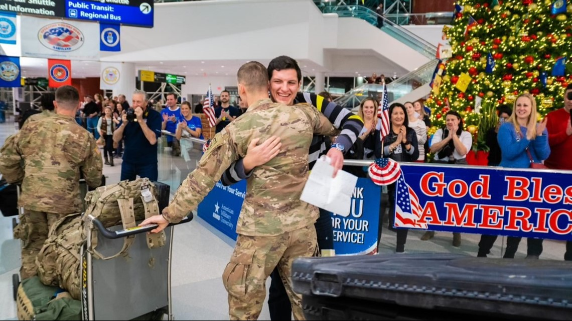 Welcome home: Community, family members greet military at airport