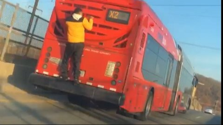 'I think that's crazy' | Person caught riding on back of DC bus