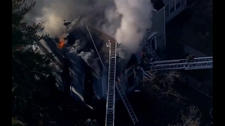 Firefighters battle 2-alarm townhouse fire in Franconia area