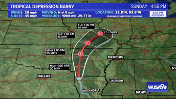 Barry weakens to a tropical depression, heavy rain continues