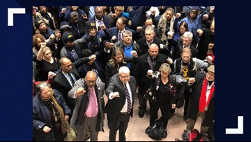 Union members hold silent protest in DC demanding answers about back pay