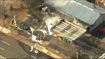 Firefighters battle heavy flames at Rockville gas station