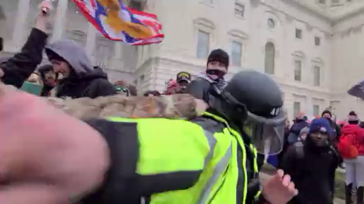 'Are you an American!?' | New video shows New Jersey man punching police during Capitol riot