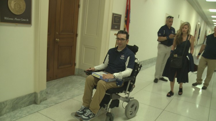 Rob Serra moves through the Halls of Congress in the wheelchair of his lost friend