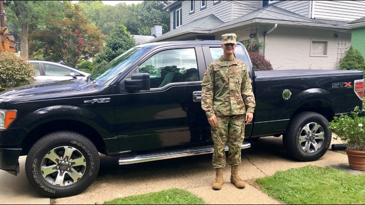 1LT Tommy Shedlick with his truck, which is registered in Maryland.
