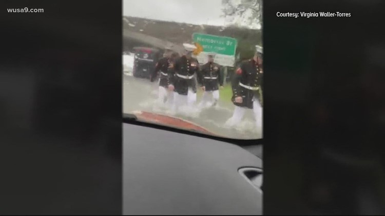 Marines help stranded woman after car becomes stuck in floodwater