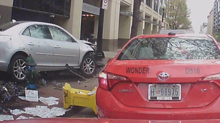 One moment they were walking down the street, the next they were trapped underneath a car crash