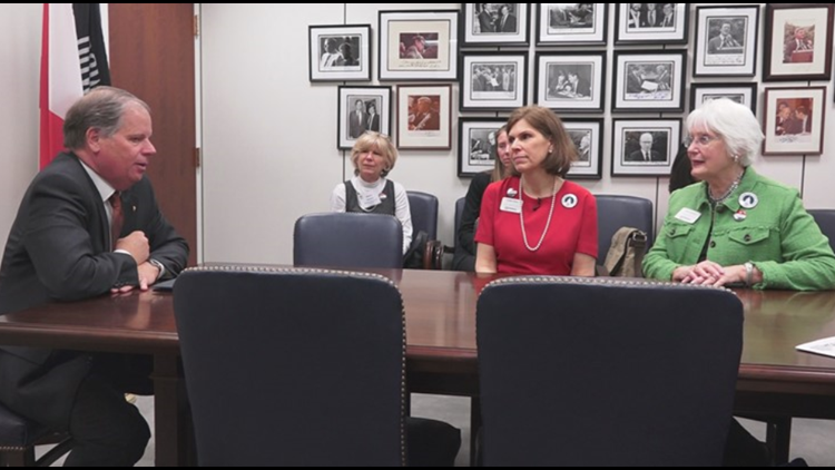 Surviving military spouse Kathy Thorp and MOAA member Anne Hartline meet with Sen. Doug Jones, D-Alabama
