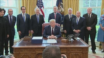 Trump signs $2 trillion coronavirus relief bill after invoking Defense Production Act