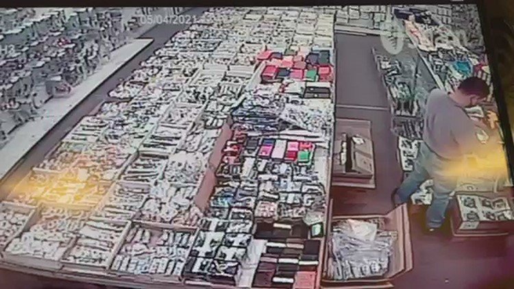 Security camera shows Asian business owner attacked by customer