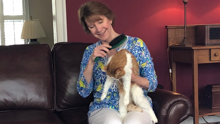 Pet owner Tania Burrell sharing a moment with her cat, Queeny.