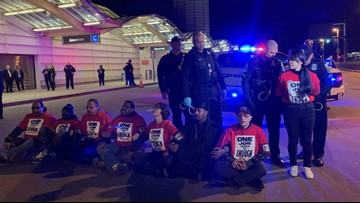 12 protesters arrested at Reagan National Airport, asking for higher pay and better healthcare
